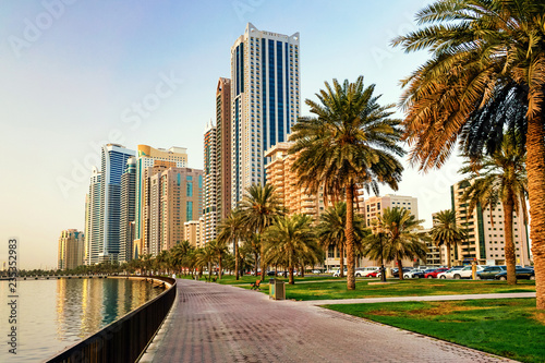 Wall Murals Dubai Morning cityscape with sun in Sharjah. UAE.
