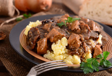Stew With Meat, Mushrooms And Vegetables Served With Groat