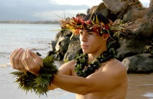 Male Hula Dancer Poses On The ...