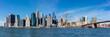 Panoramic view of New York City Manhattan skyline and Brooklyn bridge.