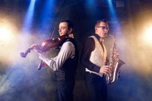 Saxophonist And Violinist Play...