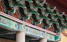 Wooden And Colorfully Patinted Roof Top Decoration Of A Buddhist Main Temple In Downtown Taichung, Taiwan, Asia