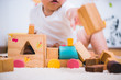 canvas print picture - Asian child building playing toy blocks wood