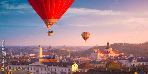 Fotografie, Obraz  Hot air balloons flying over Vilnius
