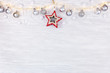 new year holidays background. white wooden board with light garlands decorated with christmas balls and stars. flat lay