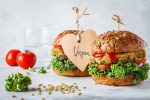 Vegan Lentil Burgers With Kale And Tomato Sauce On A White Background.