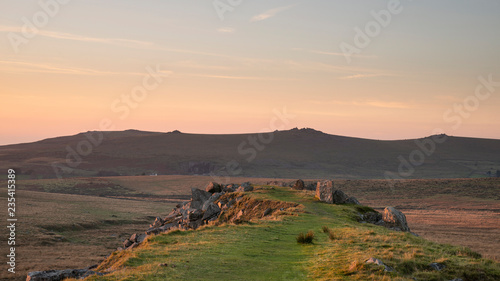 Spoed Foto op Canvas Cappuccino Stunning landscape sunset image over abandoned Foggintor Quarry in Dartmoor with raking soft sunlight over ruins and derelict buildings