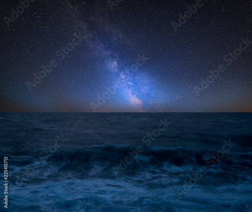 Türaufkleber Blaue Nacht Vibrant Milky Way composite image over landscape of Waves breaking onto beach