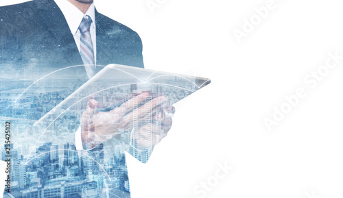Photographie Double exposure businessman using digital tablet, and cityscape