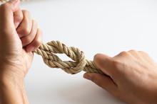 Man Checking Rope Knot