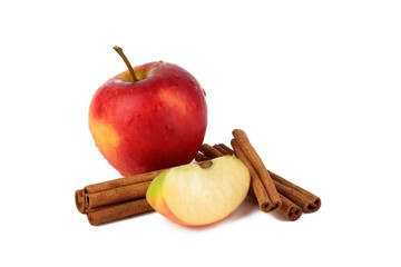 Fototapeta Red ripe apple and aromatic cinnamon sticks on white background
