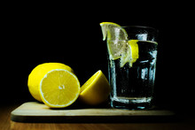 Glass Of Water And Lemon On Bl...