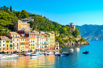 Fototapeta na wymiar Beautiful sea coast with colorful houses in Portofino, Italy. Summer landscape