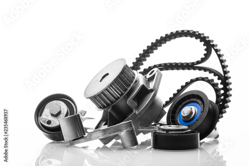 Fototapeta kit of timing belt with rollers on a white background obraz