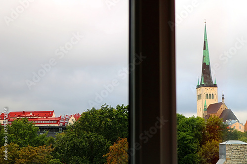 Photo  View through the window: the station (left) and the church of Oleviste (St