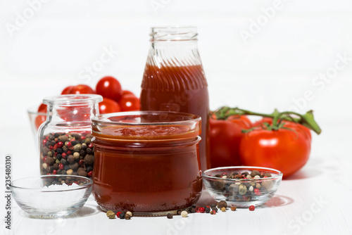 Fotobehang Kruiderij Products made with fresh tomato - sauce, juice and seasonings on white table