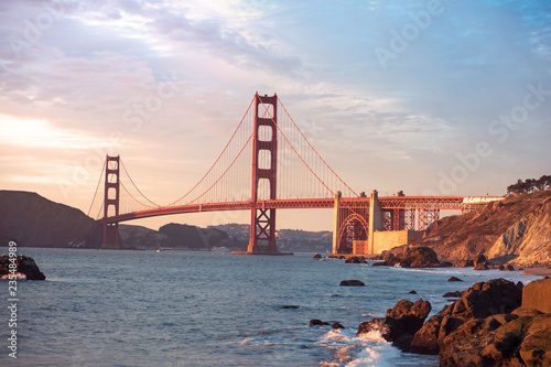 Classic panoramic view of famous Golden Gate Bridge seen from Baker Beach in beautiful golden evening light Canvas Print