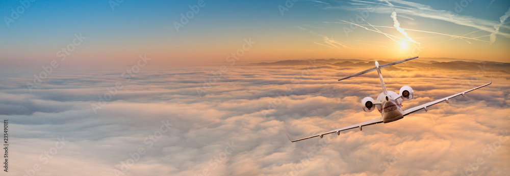 Fototapety, obrazy: Private jet plane flying above dramatic clouds.