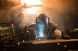 Leinwandbild Motiv Welder is welding metal part in factory
