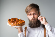 Man With A Beard With A Pie