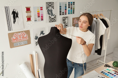 Female Clothes Designer Dressmaker Taking Dummy Mannequin Measurements With Measure Tape In Workshop Fashion Design Studio Preparing For Sewing Dressmaking New Handmade Clothes Collection Buy This Stock Photo And Explore Similar