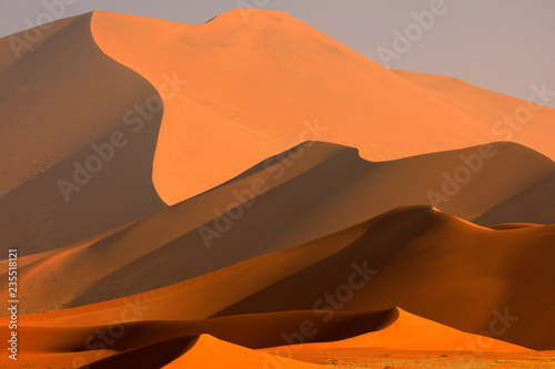 Canvas Print Big orange dune with blue sky and clouds, Sossusvlei, Namib desert, Namibia, Southern Africa