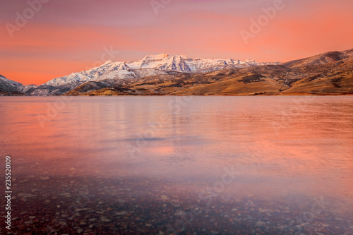 Photo Stands Coral Sunrise reflection in Deer Creek, Utah, USA.