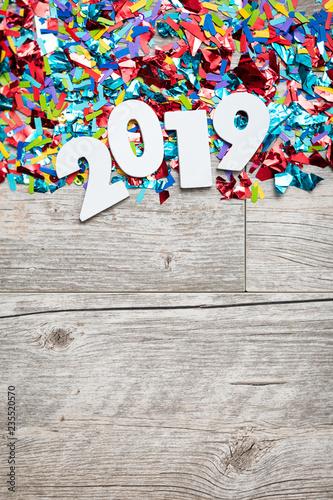 Fotografie, Obraz  NYE2019: Wooden 2019 Year Number On Confetti Background