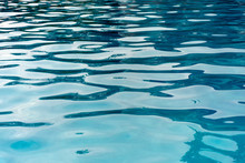 Patterns And Ripples Of Swimming Pool Water Surface