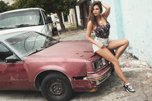 Sexy Woman Posing Beside Old Rusty Car On The Street