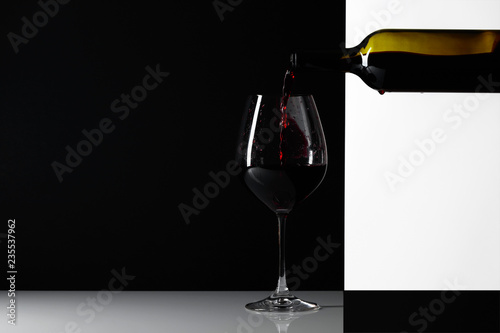 Fotografie, Obraz  Red wine is poured into a glass.