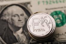 Few Ruble Coins On A Dollar Bill, Closeup