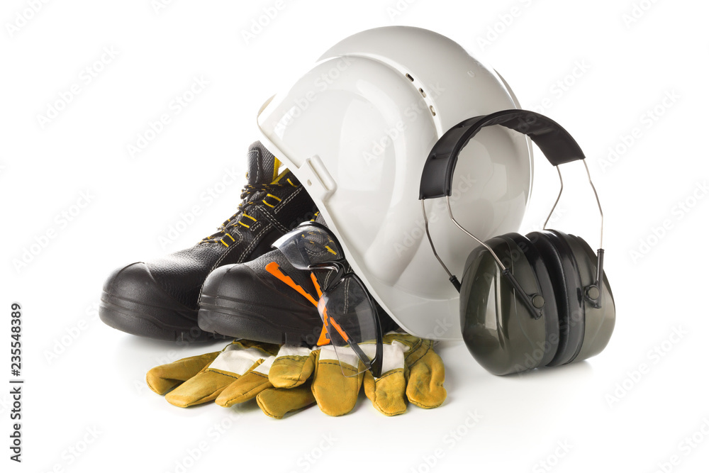 Fototapeta Work safety and protection equipment - protective shoes, safety glasses, gloves and hearing protection over white