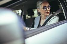 Senior Woman Driving A Car In ...