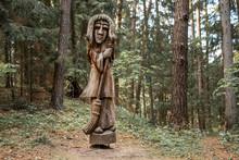 JUODKRANTE, LITHUANIA - AUGUST, 2018: Old Wooden Sculpture Statue Portrait, Witch Hill Park, Juodkrante, Curinian Spit, Lithuania.