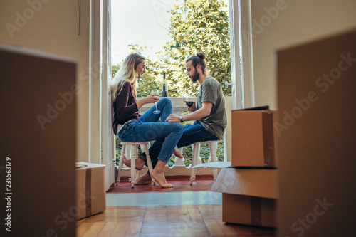 Couple enjoying a glass of wine at home