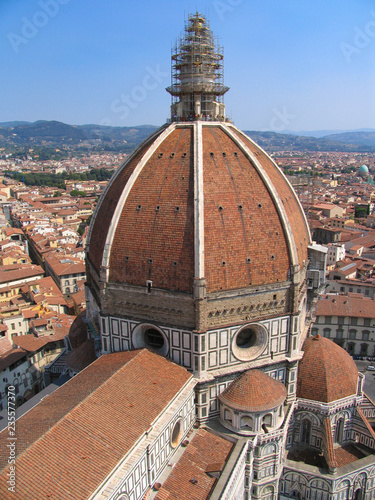 The Duomo on the skyline and red rooftops of the city of Florence, Italy