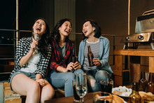 Asian Girls Having Fun Chatting On Barbecue Party