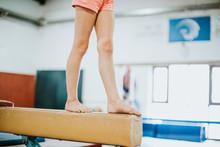 Young Gymnast Balancing On A B...