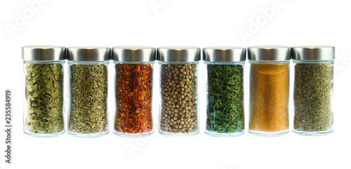 Fototapeta collection of spice and herbs seasoning in glasses bottles isolated on white background obraz