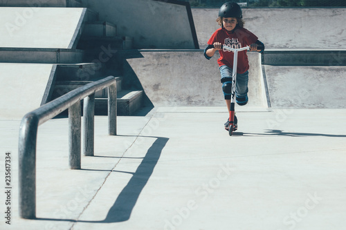 Young boy having fun in the skate park
