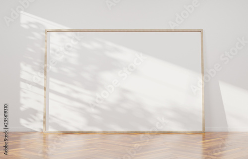Fototapeta Large horizontal frame leaning on a white wall 3D rendering obraz