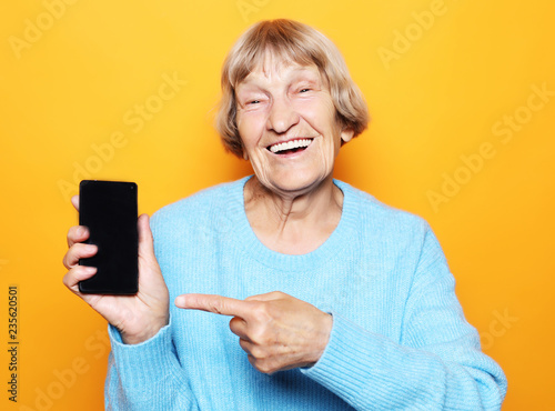 Photographie  A picture of mature woman with new smartphone.