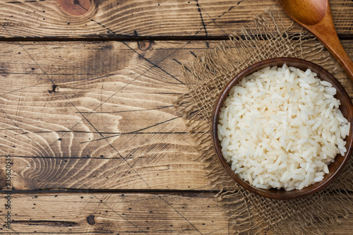 Fotografie, Obraz  White boiled rice in a wooden bowl. Rustic style. Copy space