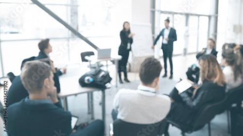 Fotografia  Blurred view of people at business training