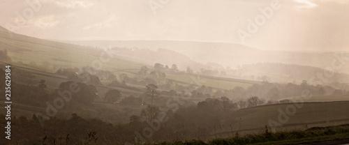 Fotografie, Obraz  Misty valley near Skipton, West Yorkshire, England, UK.