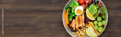Fotografie, Obraz Clean food with mixed vegetable and fruit salad on wood banner background