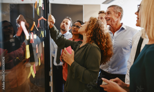Diverse businesspeople brainstorming together with sticky notes