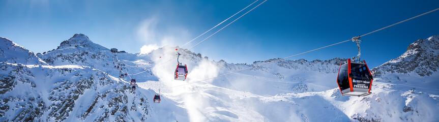 Stunning winter panorama in Tonale ski resort. View of Italian Alps from Adamelo Glacier, Italia, Europe.