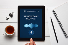 Voice Assistant Concept On Tablet Screen With Office Objects
